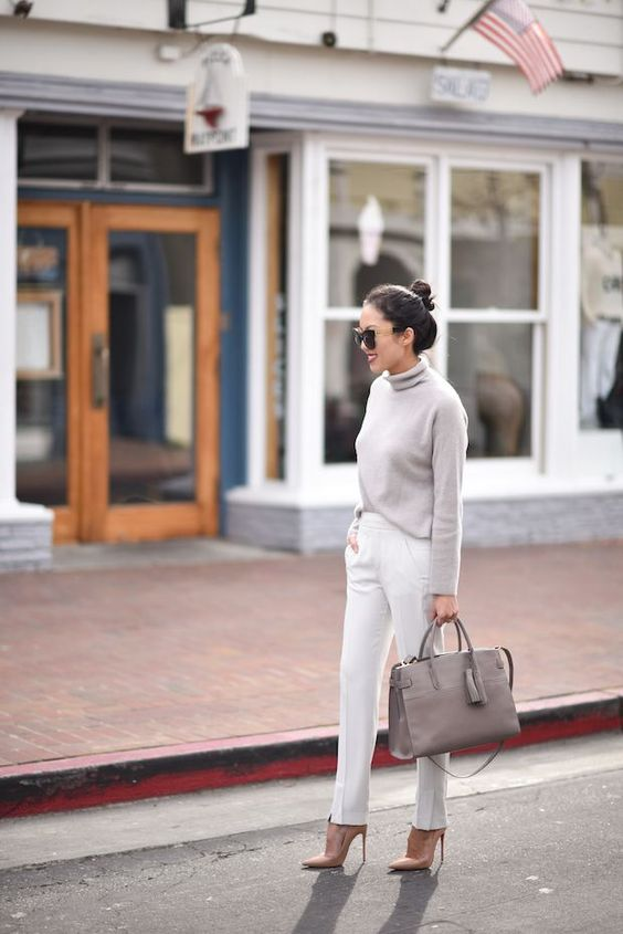 a grey turtleneck sweater, white pants, a grey bag and blush heels for a simple fall look