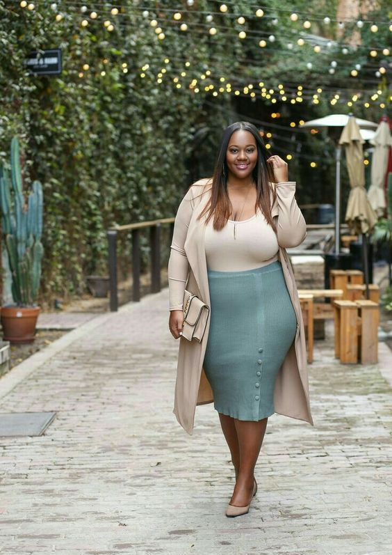 a pastel green pencil skirt, a beige top, a beige trench, beige shoes and a clutch