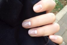 02 a reverse French manicure with nude and white is a chic idea