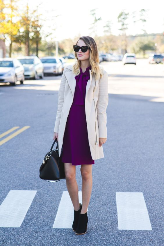 a stylish and bold work outfit with a fuchsia over the knee dress, a white trench, black booties and a bag
