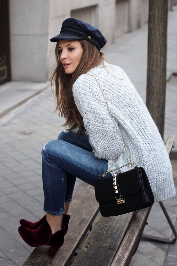 cropped jeans, a chunky knit sweater, burgundy velvet booties and a black cabbie hat