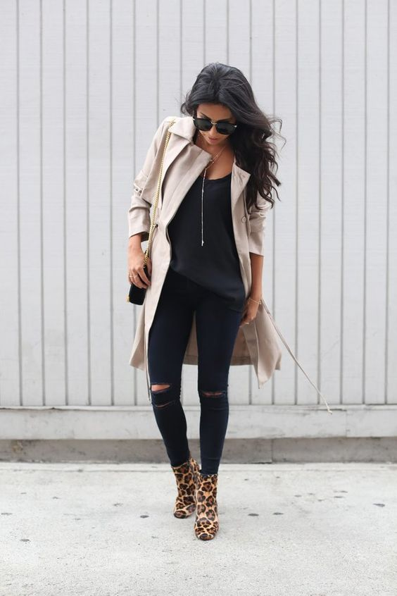 a black top, black ripped denim, leopard boots, a neutral trench for the fall