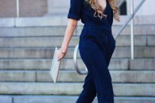 03 a bold blue velvet jumpsuit with a plunging neckline and gorgeous brown strappy shoes