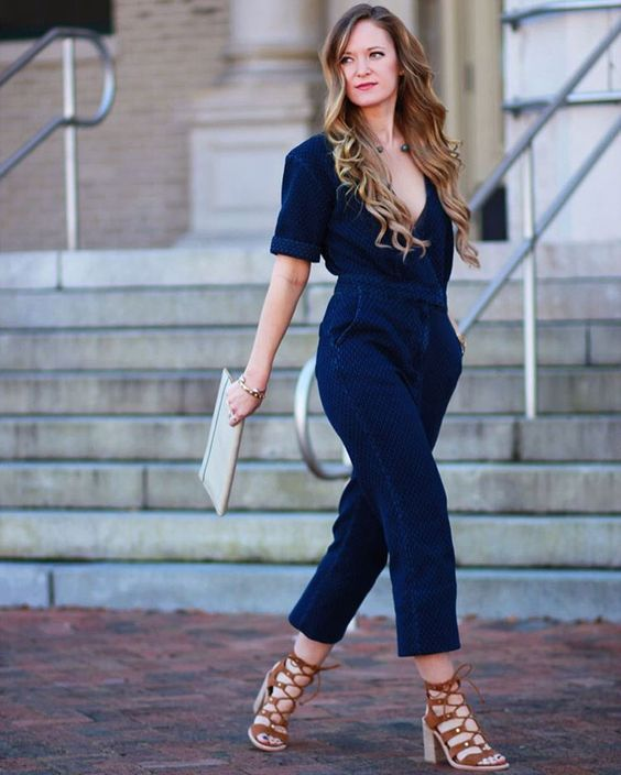 a bold blue velvet jumpsuit with a plunging neckline and gorgeous brown strappy shoes