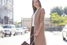 03 a casual work look with a white top, a burgundy midi skirt, a camel coat and white sneakers