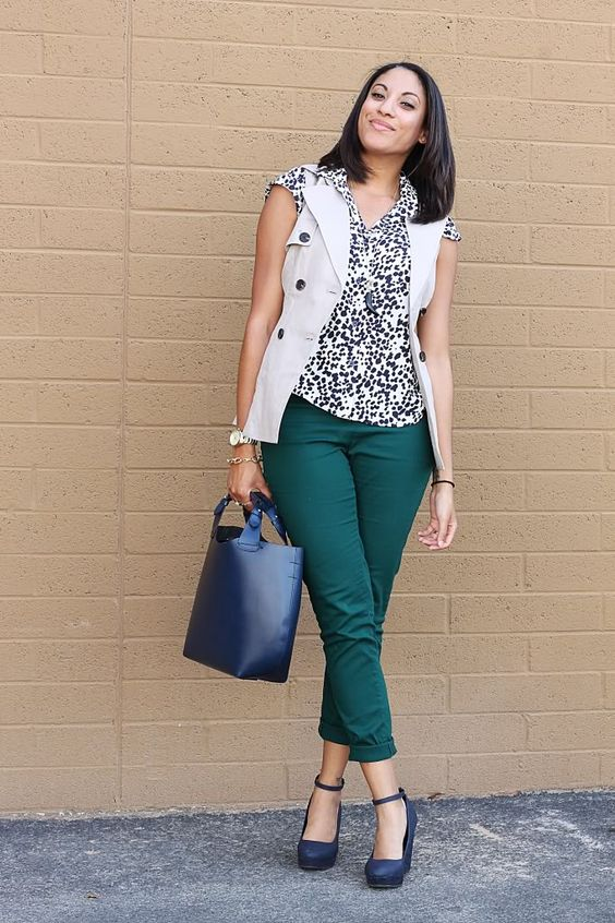 a work look for a warm fall day with emerald pants, a printed top, a white waistcoat, navy wedges and a navy bag
