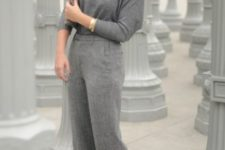 03 grey wideleg pants, a grey top, black booties and a statement bracelet