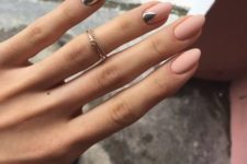 03 matte nude nails with a silver statement nail and a geometric detail for a trendy look