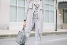 03 white jeans, a grey top, a neutral sleeveless coat, grey heels and a bag