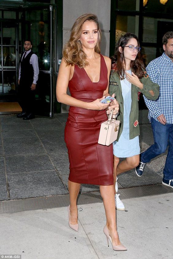 Jessica Alba making a statement in a burgundy leather dress with a deep U neckline and blush shoes