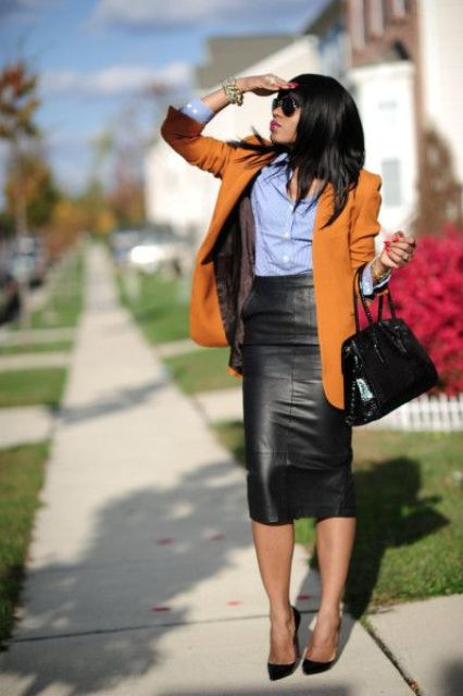 a blue shirt, a black leather midi pencil skirt, a mustard long blazer and black heels
