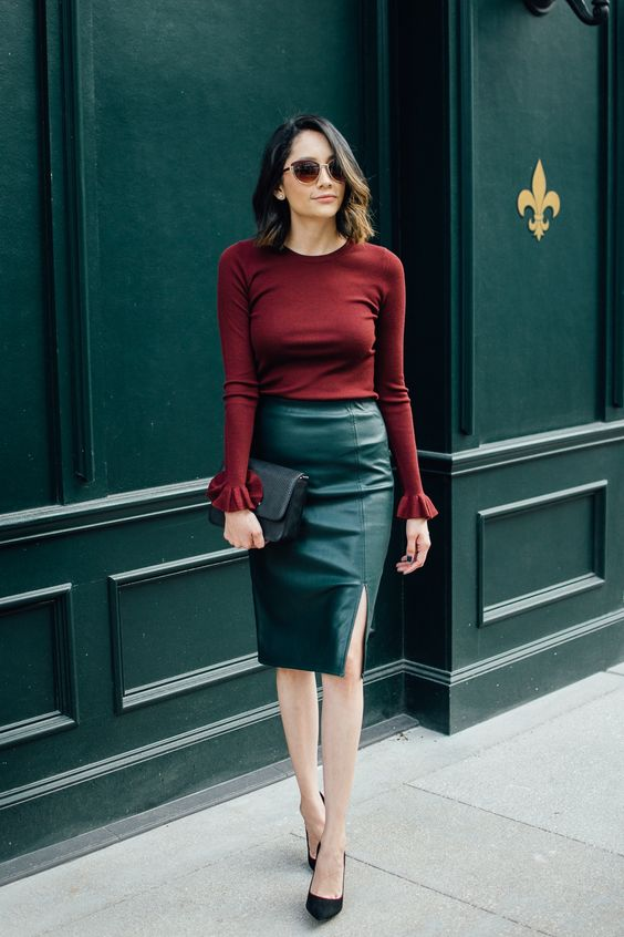 a bold burgundy top with ruffled sleeves, an emerald leather skirt and black shoes for the fall