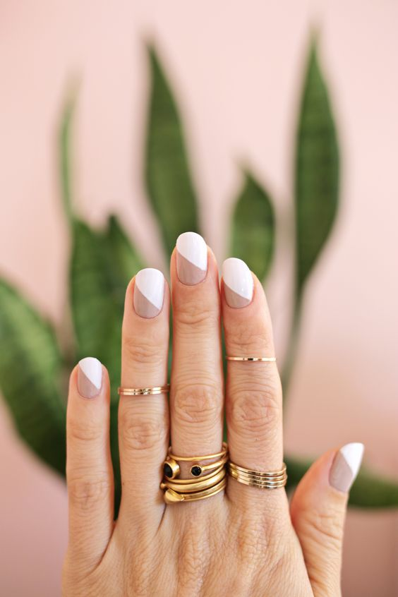 a modern touch on a French manicure with nude and white and a geometric touch