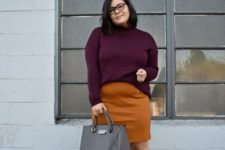 04 a mustard over the knee skirt, a plum-colored sweater, plum-colored boots and a grey bag