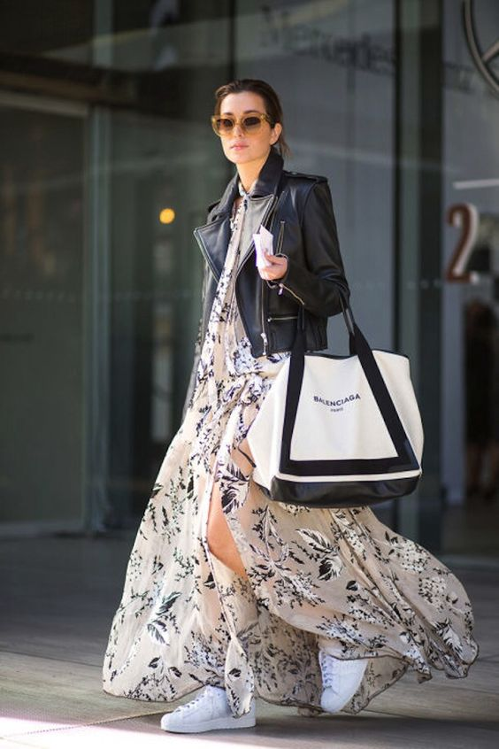 a neutral floral print maix dress with a slit, a black leather jacket, white sneakers and a shopper