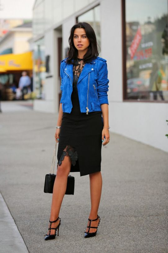 a party look with a black knee dress with lace inserts, a blue leather jacket, black studded shoes