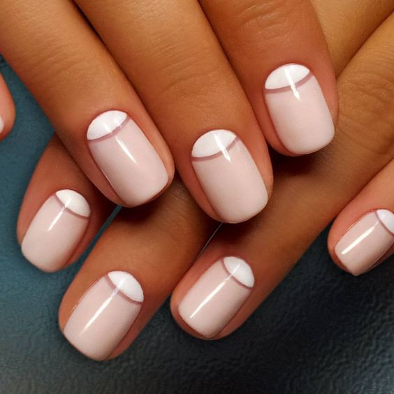 a stylish reverse French manicure with a separating line
