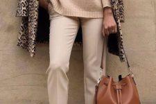 04 a tan sweater, tan pants, a camel bag, leopard flats and a coat