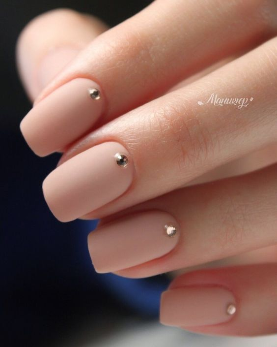 matte nude nails with copper rhinestones for a party or a special occasion
