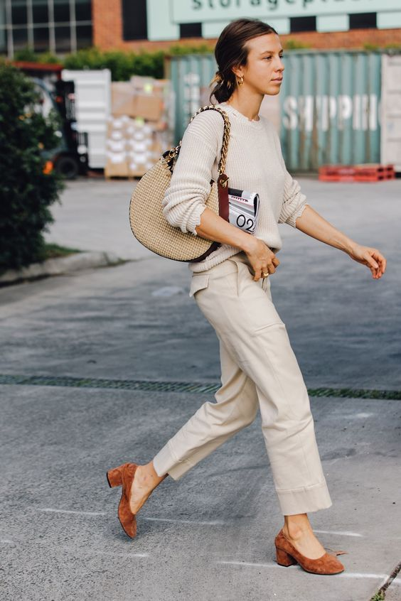 neutral pants, a neutrla sweater, a cool bag and rust shoes for a retro-inspired look