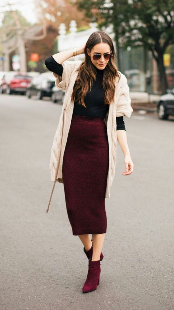 a black turtleneck, a burgundy pencil midi, matching booties and a cardigan