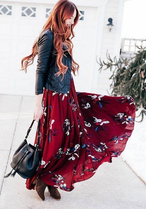 a deep burgundy floral maxi dress, a black leather jacket, a black bag and brown booties