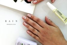 05 a modern take on a French manicure with half moons is a stylish idea