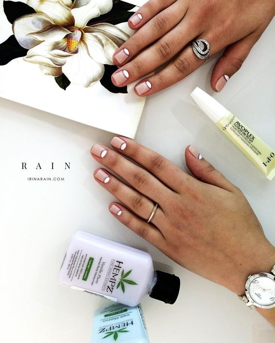 a modern take on a French manicure with half moons is a stylish idea