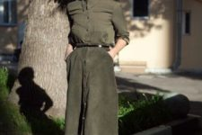 05 a muted green shirt, a matching A-line knee skirt with pockets and a belt and nude heels