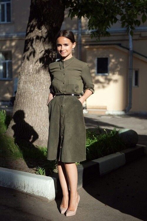 a muted green shirt, a matching A-line knee skirt with pockets and a belt and nude heels