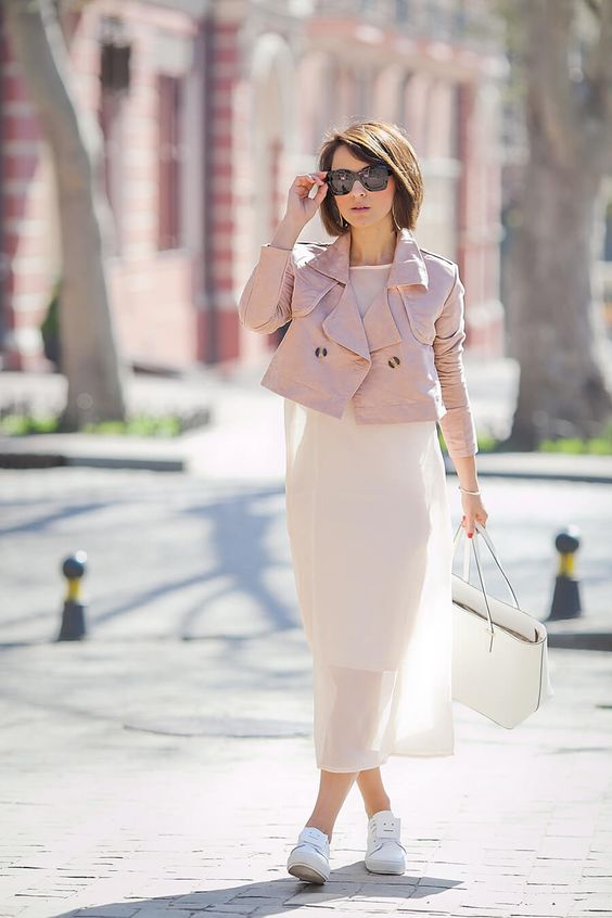 a white airy dress, a pink cropped leather jacket, white sneakers and a white bag