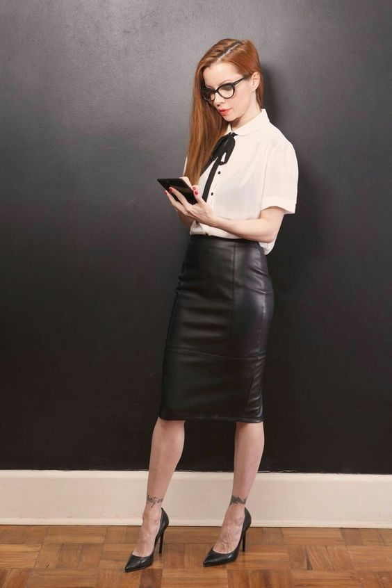 a white shirt with a black bow, a black leather skirt, black heels for a stylish look