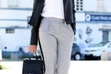 05 grey checked pants, a logo tee, white sneakers and a black leather jacket