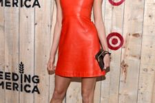 06 Karlie Kloss wearing a sheath red leather dress with a lace top and strappy heels