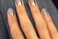 06 a matte grey manicure with gold geometric touches for a statement