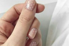 06 a nude manicure with white polka dots is a timeless and girlish idea to try