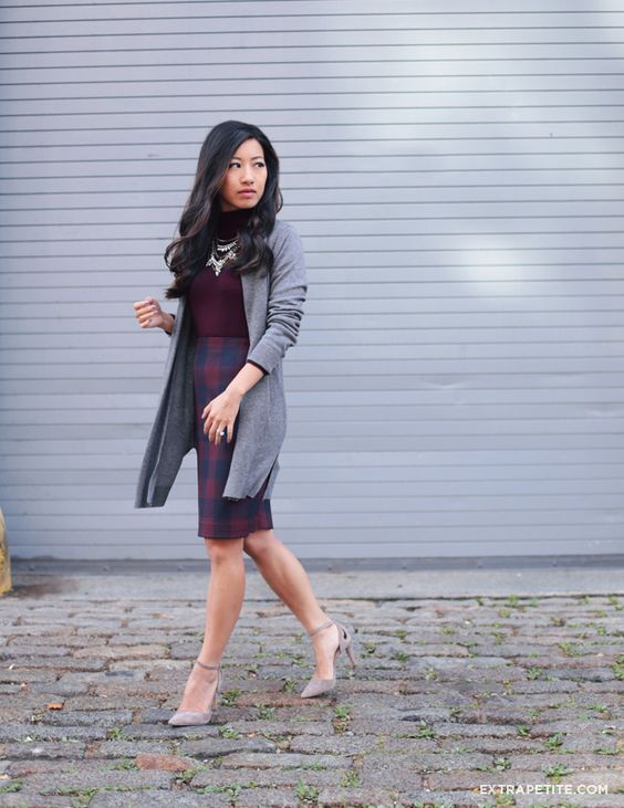 a plum turtleneck, a checked over the knee skirt in plum and navy, a grey cardigan and grey shoes