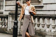 06 a white logo tee, a brown wrap skirt with buttons, white sneakers and a amber jacket
