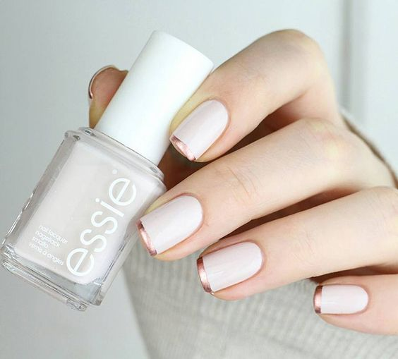 a white manicure with copper tips is a modern and fresh idea instead of a traditional combo