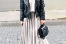 06 a white top, an off-white pleated skirt, a black leather jacket, black boots and a bag