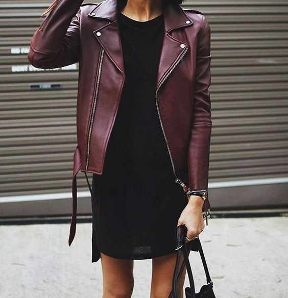 black mini dress, a burgundy leather jacket and a black bag for a minimal chic look