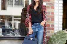 06 rough edge jeans, a black top, a fall-colored printed kimono and a black bag