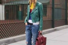 07 a colorful striped sweater, cropped blue jeans, heels, a burgundy leather bag and a grene leather jacket