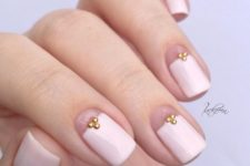 07 a girlish take on French nails with a large creamy tip and little rhinestones for a chic look
