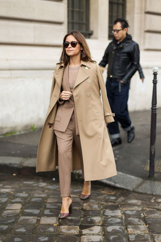 a gorgeous beige pantsuit, a matching top, printed shoes and a camel trench