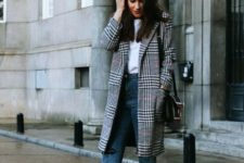 07 a white tee, blue jeans, white sneakers and a plaid coat for a stylish and trendy look