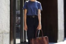 07 black jeans, a blue tee, brown combat boots and a brown bag