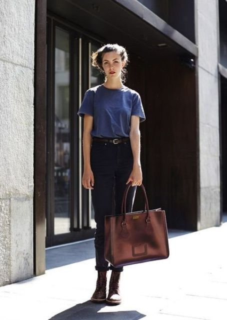 black jeans, a blue tee, brown combat boots and a brown bag