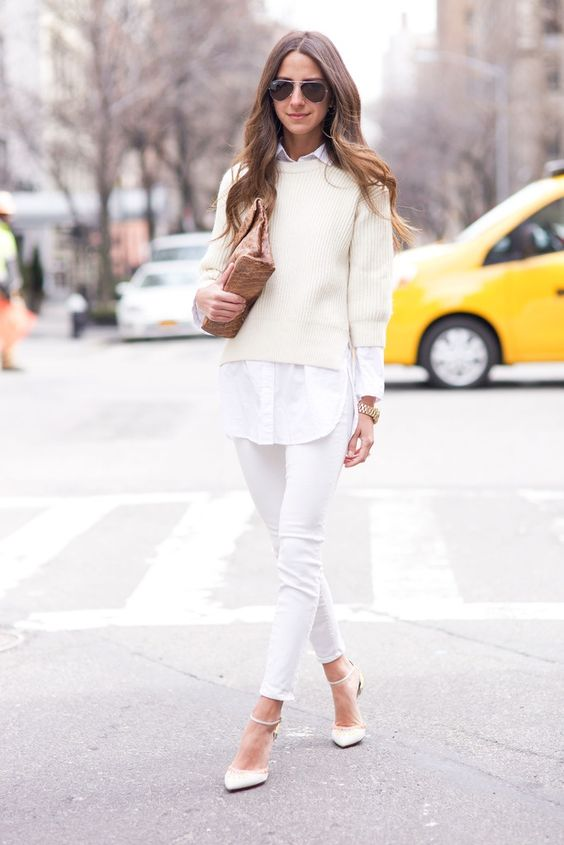 white jeans, a white shirt, a white sweater, white heels and a brown bag