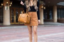 08 a black top with long sleeves, a rust high waist suede skirt with buttons and a mustard bag
